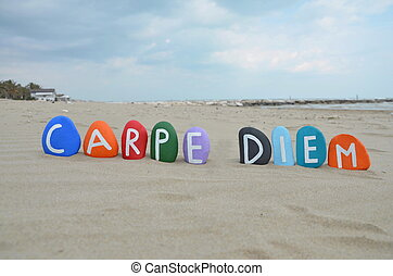 Carpe Diem concept on colourful sto - Stones composition of...