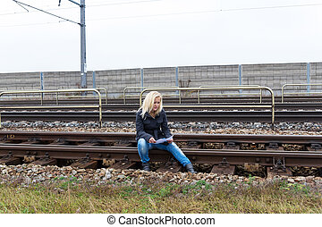 woman with suicide thoughts on track - a young woman with...