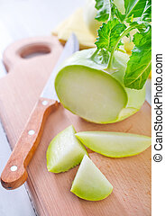Cabbage kohlrabi on Wooden Kitchen Board
