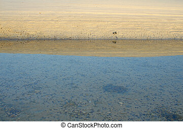 White beach sand with bright blue sea in morning
