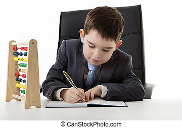 kid dressed up as a business person - young small boy...
