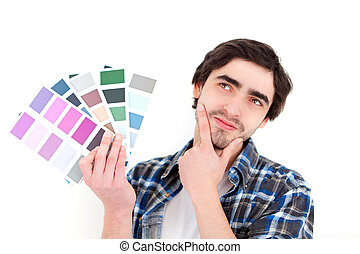 Attractive young man choosing color of his flat - View of a...