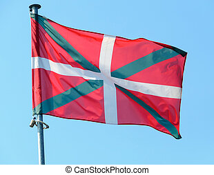 Basque country flag, blue sky background