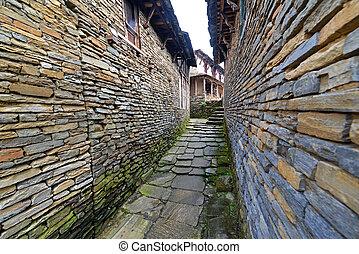 Narrow alley between stone houses in Ghandruk village....