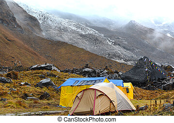 Storm in the Annapurna Base Camp, Nepal - Expedition tents...