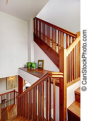 View of staircase and shelf - Wooden staircase with railings...