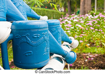 Blue watering pot in the garden
