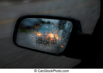 Car Mirror in Rain and Traffic - Car mirror in rain...