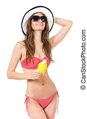 Woman in swimsuit - Female applying cosmetic cream for skin...