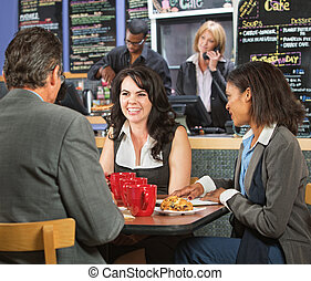 Happy Business People in Cafe - Happy business executives...