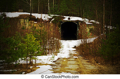 Tunnel Abandoned military base - winter landscape with...