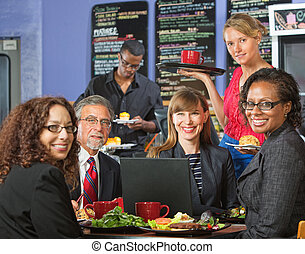 Smiling Executives with Barista - Smiling executives with...