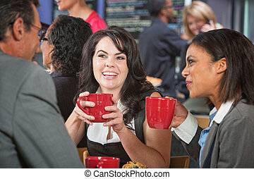 Smiling Female with Friends in Cafe - Smiling woman with...