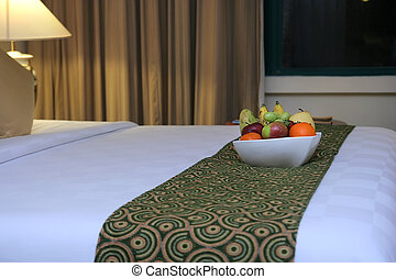 luxury hotel bed with fruit