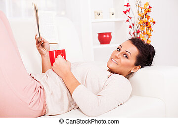 Leisure Activity - Beautiful young woman resting with book...