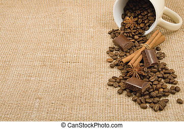 coffee grain, cinnamon, chocolate and anise on a background...