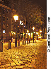 Medieval street in Amsterdam the Netherlands by night