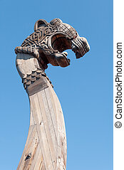 wooden front part of the ancient Viking ship - element of...