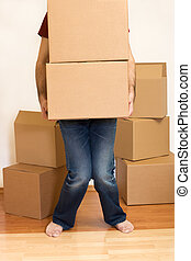 Man struggling with cardboard boxes - moving concept