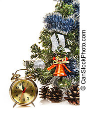 clock,bumps on the background of a decorated Christmas tree in the white
