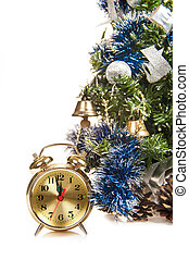 round-the-clock on the background of a decorated Christmas tree in the white