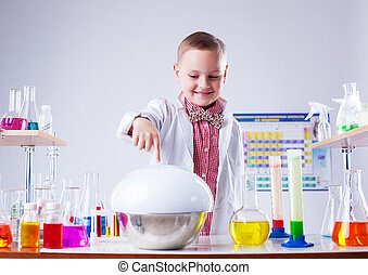 Adorable little boy watching reaction of reagent, close-up