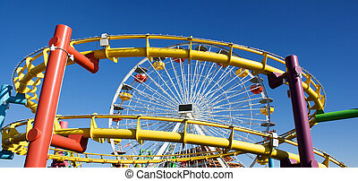 Roller Coaster in the Summer - Rollercoaster and clear blue...