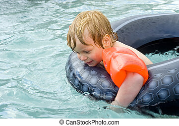 Swimming boy - Young boy having fun in an outdoor swimming...