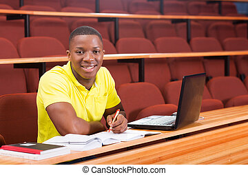 african college boy sitting in classroom