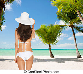 woman posing in white bikini - summer and holidays concept -...