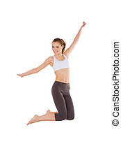 Woman jumping. Beautiful young woman in sports clothing jumping while isolated on white