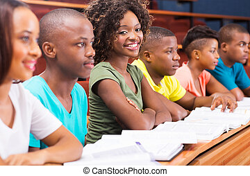 group of african college students studying together in...