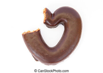 Chocolate covered gingerbread heart partially bitten -...