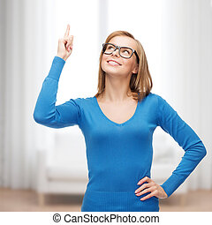 smiling woman pointing her finger up