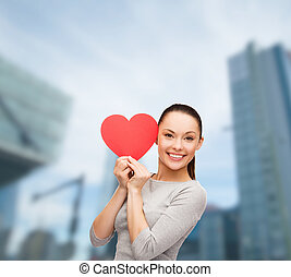 smiling asian woman with red heart - happiness, love and...