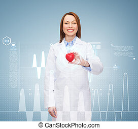 smiling female doctor with heart - healthcare and medicine...