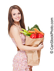 Cute grocerie girl. - Portrait of a beautiful fit young...