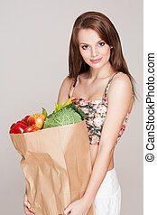 Healthy shopping - Gorgeous fit slender young brunette woman...