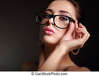 Sexy woman looking hot on modern glasses on dark background