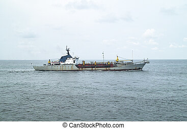 dredger in the sea during navigation in calm sea