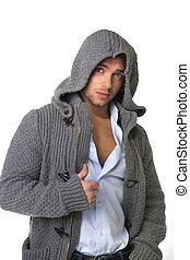 Good looking young man wearing winter hoodie sweater on...