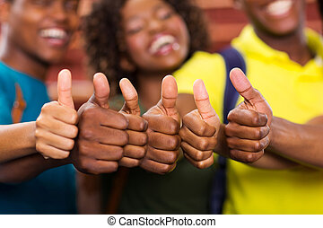 group of african friends thumbs up close up
