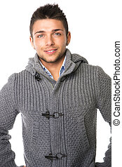 Smiling young man wearing winter sweater, isolated