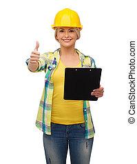 smiling woman in helmet with clipboard - repair,...