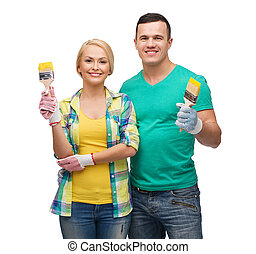 smiling couple with paintbrush
