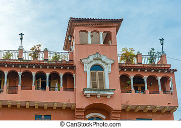 Colonial house balcony with flowers and plants