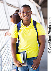african american college student on campus - happy african...