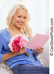 smiling woman with card and bouquet of flowers - holiday,...