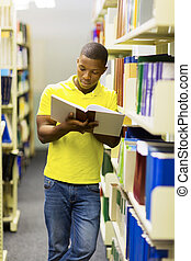 african college boy reading a book