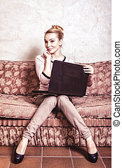 Business woman using computer Internet home technology...